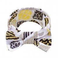 Повязка на голову с бантиком светло-желтые камешки